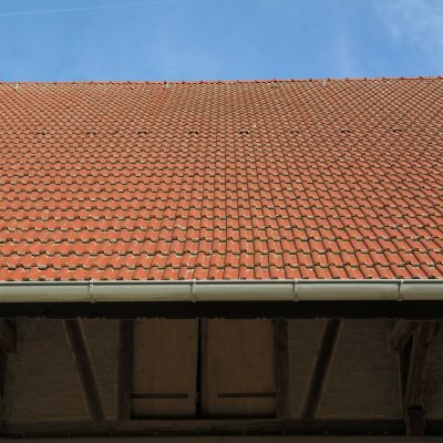 Ceramic roof tiles and gutter