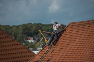 Roofer fixing leaking tiles in Toowoomba